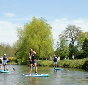 Stand-up paddle boarding.